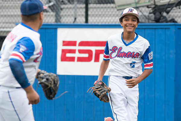08/06/19 Wesley Bunnell | Staff New Jersey defeated Maryland in a Mid-Atlantic Little League tournament game on Tuesday afternoon at Breen Field in Bristol. First baseman Jayden Capindica (8) smiles after ending an inning with an unassisted out at first base.