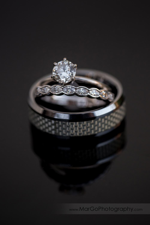 wedding rings on black table