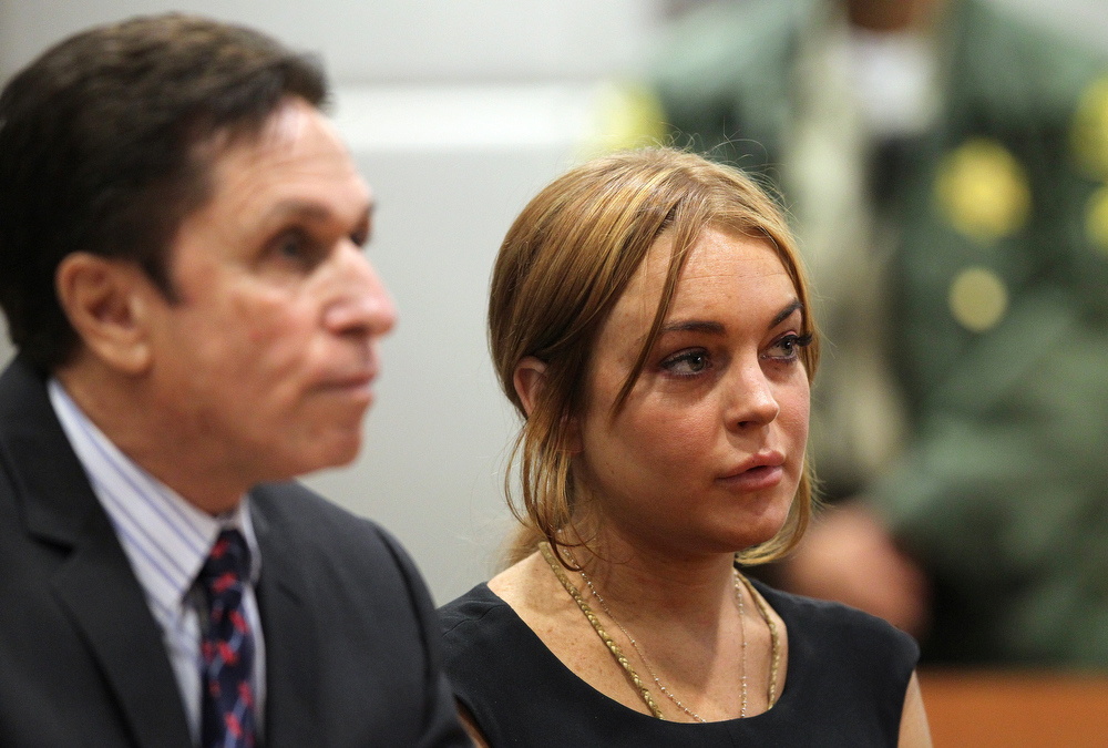Description of . Troubled actress Lindsay Lohan appears in court for a pretrial hearing with her new lawyer Mark Heller before Judge Stephanie Sautner at the Airport Branch Courthouse of Los Angeles Superior Court on January 30, 2013 in Los Angeles, California. Lohan is charged with three misdemeanor counts involving a car crash - willfully resisting, obstructing or delaying an officer, providing false information to an officer and reckless driving. She is also accused of violating her probation in a misdemeanor jewelry theft case.  (Photo by David McNew/Getty Images)