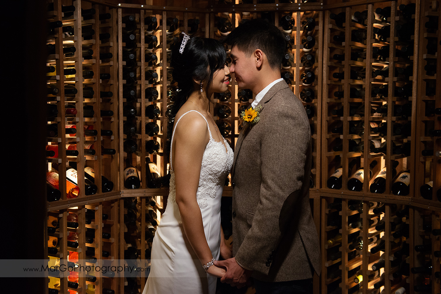bride and groom kissing in vine cellar at Long Branch Saloon & Farms in Half Moon Bay