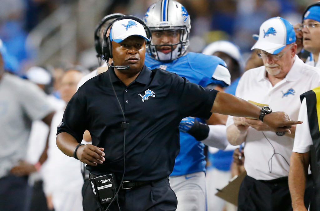 . Detroit Lions head coach Jim Caldwell walks the sidelines against the Cleveland Browns in the second half of a preseason NFL football game at Ford Field in Detroit, Saturday, Aug. 9, 2014. (AP Photo/Rick Osentoski)