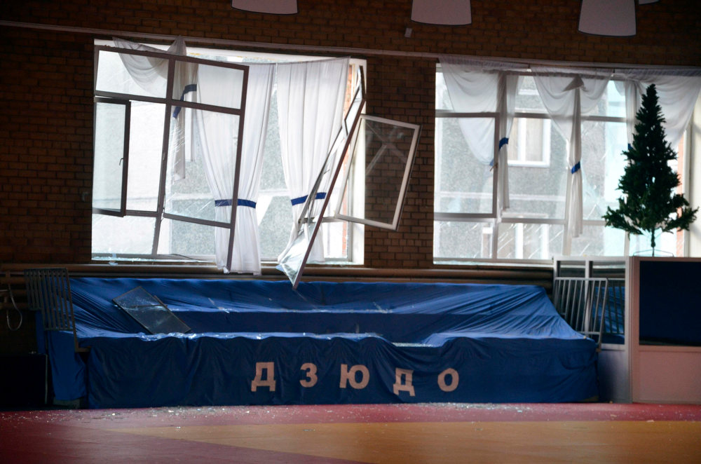 . Broken windows and debris are seen inside a sports hall following sightings of a falling object in the sky in the Urals city of Chelyabinsk February 15, 2013. A powerful blast rocked the Russian region of the Urals early on Friday with bright objects, identified as possible meteorites, falling from the sky, emergency officials said. REUTERS/OOO Spetszakaz