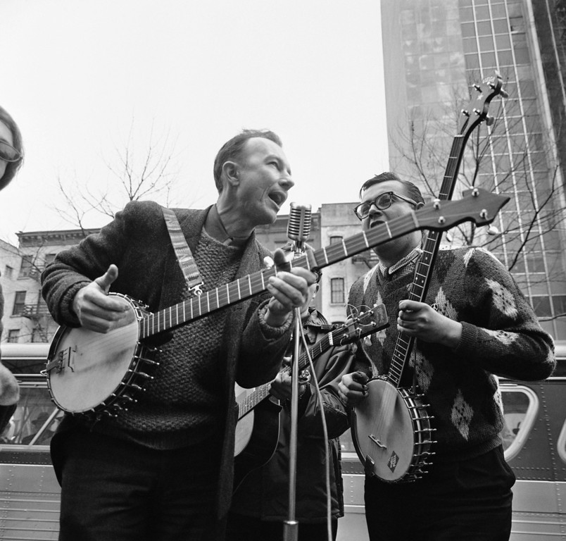 . File-This May 13, 1975, file photo shows folk singer Pete Seeger, left, performing at the Rally for D�tente at Carnegie Hall in New York.   (AP Photo/Richard Drew, File)