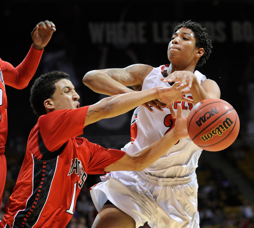 . BOULDER, CO. - MARCH 16: Raptors senior forward Sean Watkins (10) knocked the ball away from East guard Jevon Griffin (2) in the second half. The Eaglecrest High School boy\'s basketball beat Denver East 63-44 in the 5A championship game Saturday, March 16, 2013 at the Coors Events Center in Boulder.  (Photo By Karl Gehring/The Denver Post)