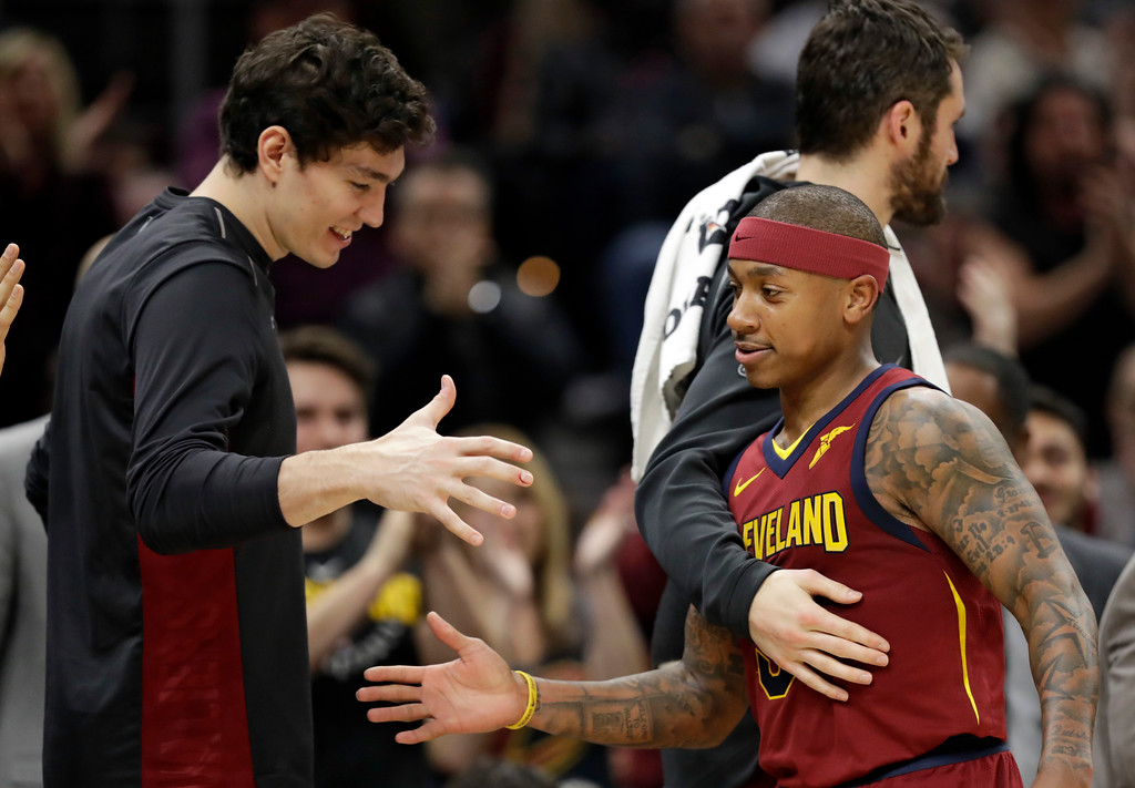 . Cleveland Cavaliers\' Isaiah Thomas is congratulated by teammates as he walks to the bench in the second half of an NBA basketball game against the Portland Trail Blazers, Tuesday, Jan. 2, 2018, in Cleveland. The Cavaliers won 127-110. (AP Photo/Tony Dejak)