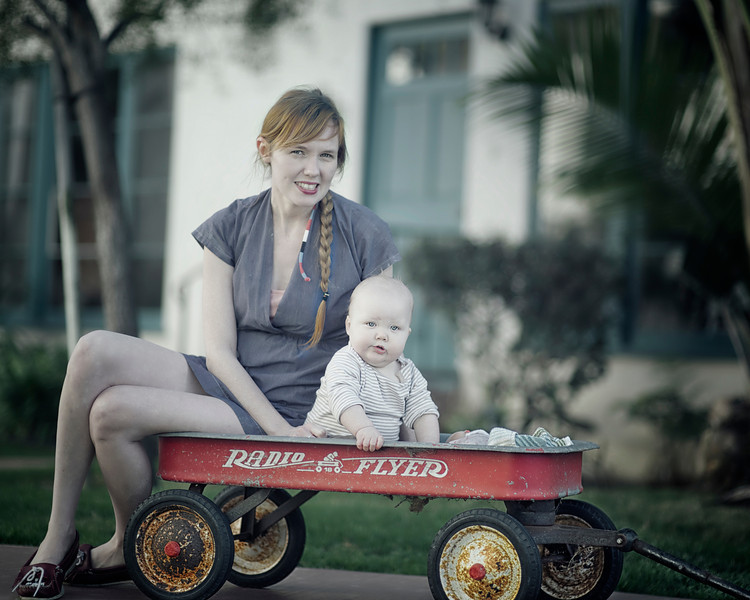 My sister Liz and her baby Darla sitting in an old Radio Flyer enjoying a Sunday afternoon in beautiful Coronado California