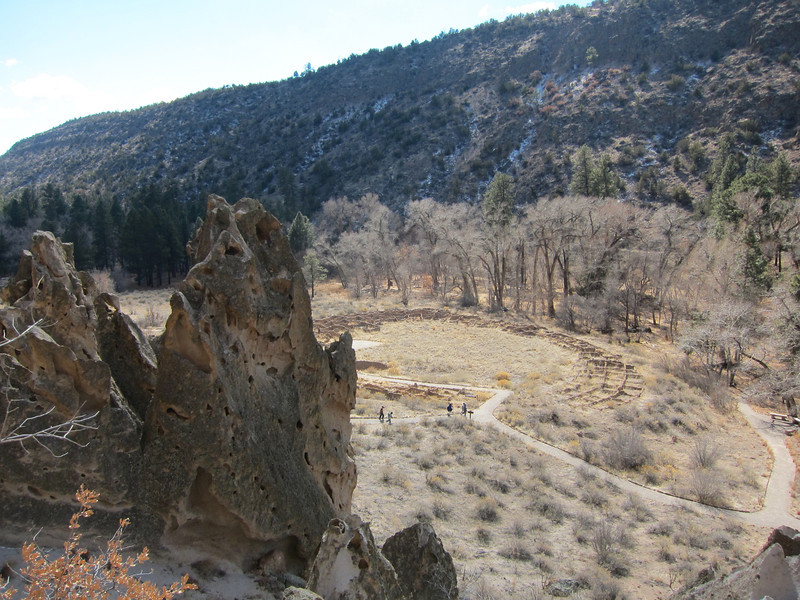 View of pueblo from cliffs at Bandelier.