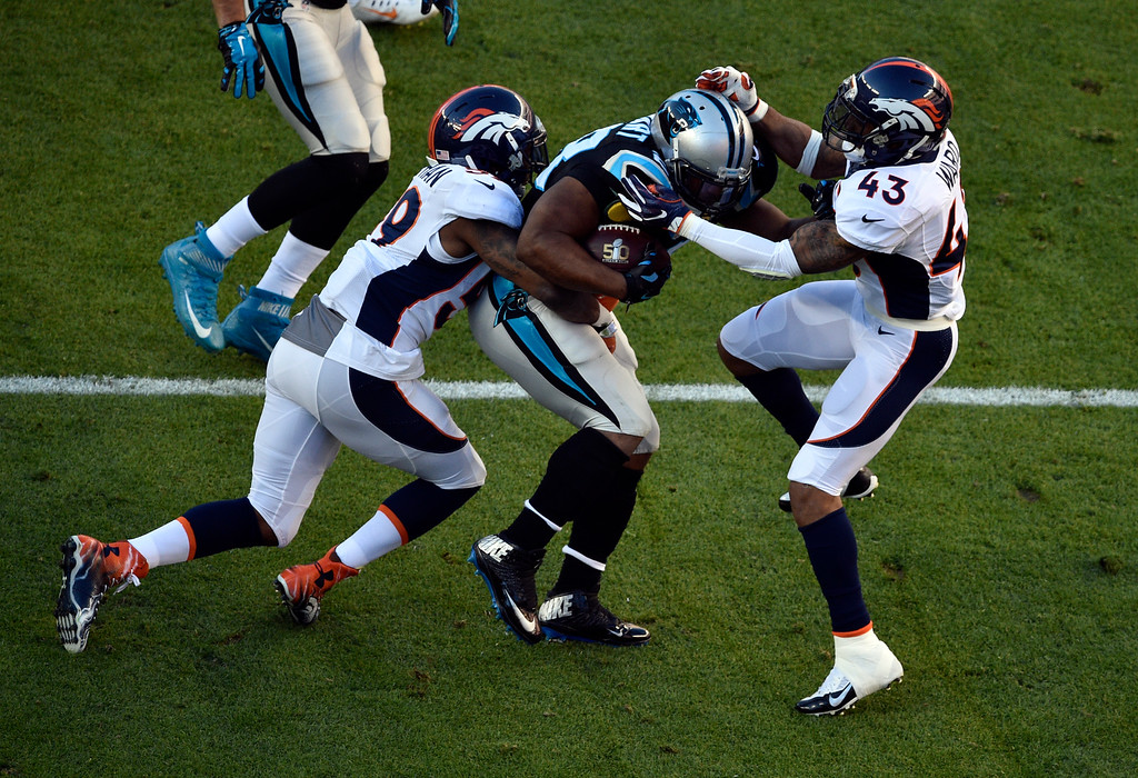. SANTA CLARA, CA - FEBRUARY 7: Danny Trevathan (59) of the Denver Broncos takes down Jonathan Stewart (28) of the Carolina Panthers in the first quarter.  The Denver Broncos played the Carolina Panthers in Super Bowl 50 at Levi\'s Stadium in Santa Clara, Calif. on February 7, 2016. (Photo by Helen H. Richardson/The Denver Post)