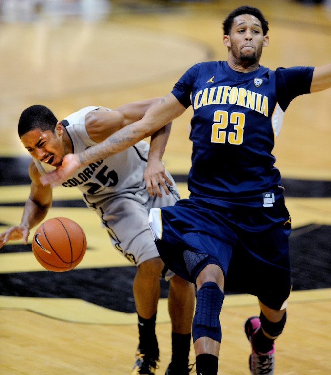 . Allen Crabbe (23) of Cal, slams into Spencer Dinwiddie of CU  for the foul during the second  half of the January 27th, 2013 game in Boulder. Cliff Grassmick/The Daily Camera