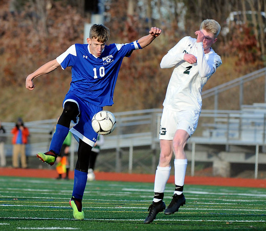 11/15/2019 Mike Orazzi | Staff Bristol Eastern's Jacob Woznicki (10) and Guilford's John Kosh (1) during the Class L Quarterfinal State Boys Soccer Tournament at Eastern on Friday.
