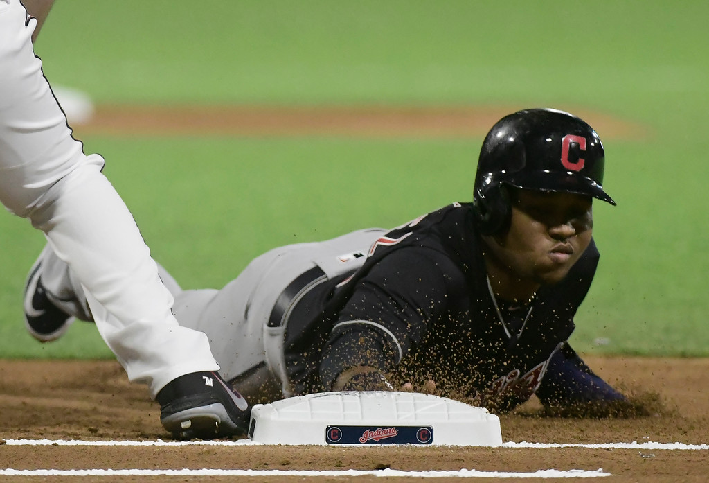 . Cleveland Indian\'s infielder Jose Ramirez slides safely to first in the first inning during the final game of a two-game Mayor League Series against the Minnesota Twins at the Hiram Bithorn Stadium in San Juan, Puerto Rico, Wednesday, April 18, 2018. (AP Photo/Carlos Giusti)
