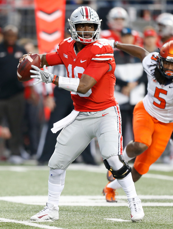 . Ohio State quarterback J.T. Barrett drops back to pass against Illinois during the first half of an NCAA college football game Saturday, Nov. 18, 2017, in Columbus, Ohio. (AP Photo/Jay LaPrete)