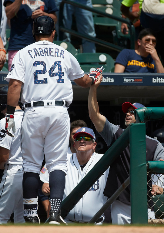 . Detroit Tigers Miguel Cabrera (24) receives congratulations from manager Brad Ausmus after he hits a home run against the Cleveland Indians during the third inning in the first baseball game of a doubleheader in Detroit, Saturday, July 1, 2017. (AP Photo/Rick Osentoski)