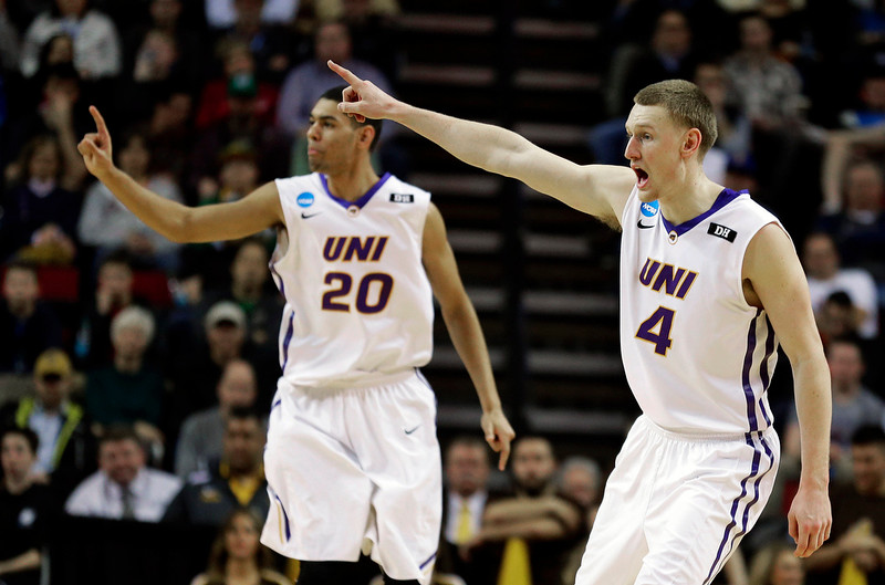 . Northern Iowa\'s Paul Jesperson (4) and Jeremy Morgan (20) celebrate at the end of the second half of an NCAA tournament college basketball game against Wyoming in the Round of 64 in Seattle, Friday, March 20, 2015. Northern Iowa beat Wyoming 71-54. (AP Photo/Ted S. Warren)