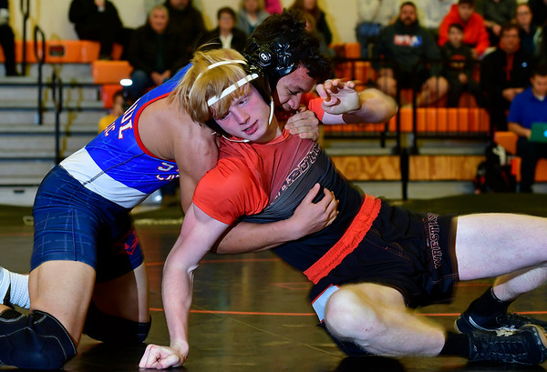 1/9/2019 Mike Orazzi | Staff St. Paul's Eric Atkison and Terryville's Bailey Schuster in a 152 match at Terryville High School Wednesday night.