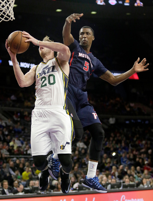 . Detroit Pistons\' Kentavious Caldwell-Pope (5) tries to defend on a shot by Utah Jazz\'s Gordon Hayward (20) during the first half of an NBA basketball game Sunday, Nov. 9, 2014, in Auburn Hills, Mich.  (AP Photo/Duane Burleson)