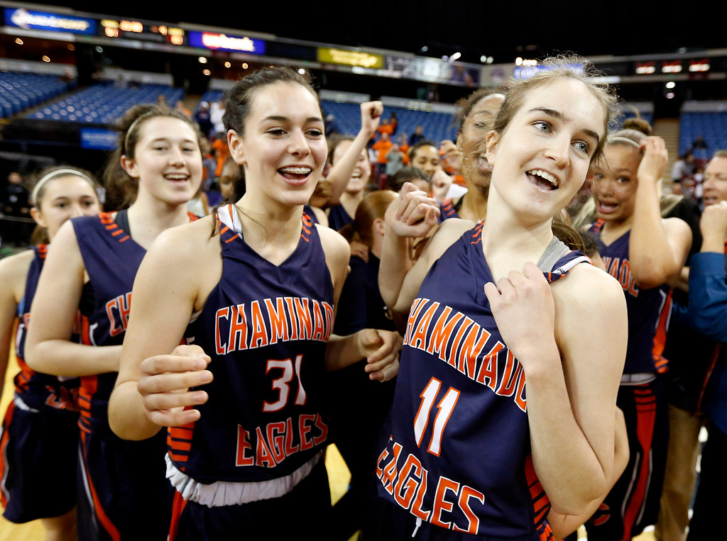 . Chaminade\'s Isabel Newman, left, and Zoe Tinsley and the rest of the team celebrate after defeating Archbishop Mitty 80-51 in the girls\' Division 2 CIF basketball championship game Saturday, March 29, 2014, in Sacramento, Calif. (AP Photo/Rich Pedroncelli)