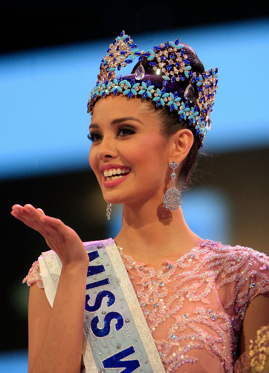 . Newly crowned Miss World Megan Young of the Philippines, smiles after winning the Miss World contest, in Nusa Dua, Bali, Indonesia, Saturday, Sept. 28, 2013. (AP Photo/Firdia Lisnawati)