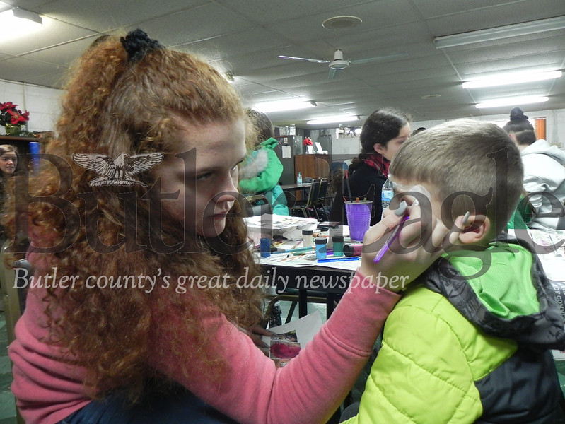 Girl Scouts painted the faces of attendees to the 6th annual Chicora Light-Up Night on Sunday.  Photo by Gabriella Canales.