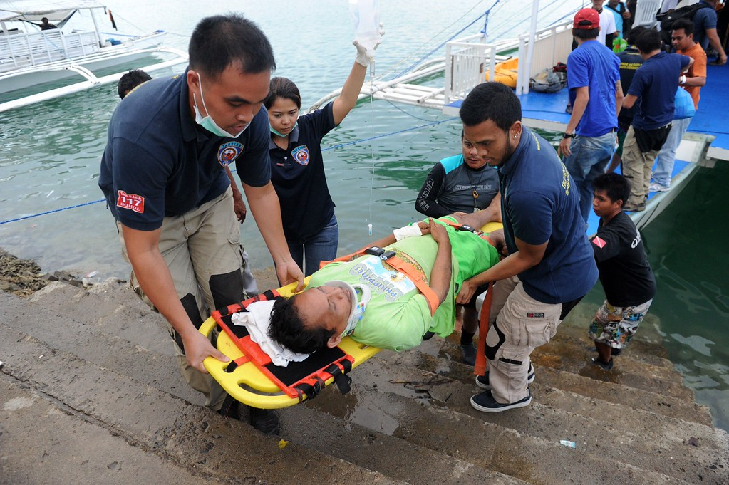 . A man injured in a 7.1-magnitude earthquake in the central Philippines is helped out of an outrigger boat on October 17, 2013 in Tagbilaran, the provincial capital of the island of Bohol that took the brunt of the quake damage.   AFP PHOTO / Jay DIRECTOJAY DIRECTO/AFP/Getty Images