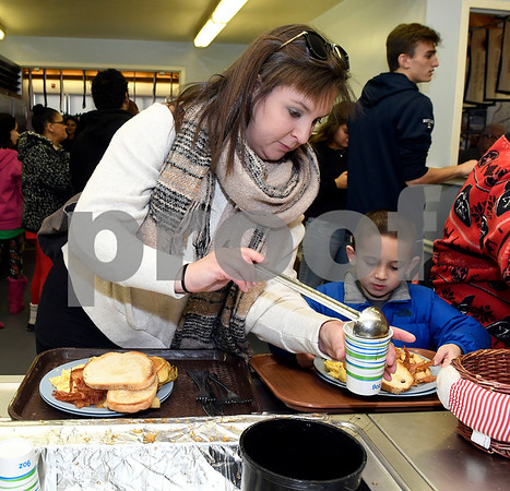 12/2/2017 Mike Orazzi | Staff Caitlin Gimpl and her son Dillon,6, get breakfast during the 24th Annual Breakfast with Santa at Giamatti Little League Center Saturday morning.