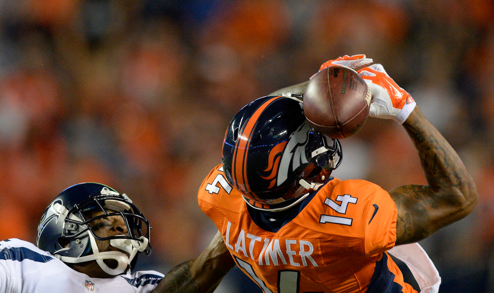 . Denver Broncos wide receiver Cody Latimer (14) can\'t hold on to a pass as Seattle Seahawks cornerback A.J. Jefferson (32) defends on the play during the third quarter August 7, 2014 at Sports Authority Field at Mile High Stadium.  (Photo by John Leyba/The Denver Post)