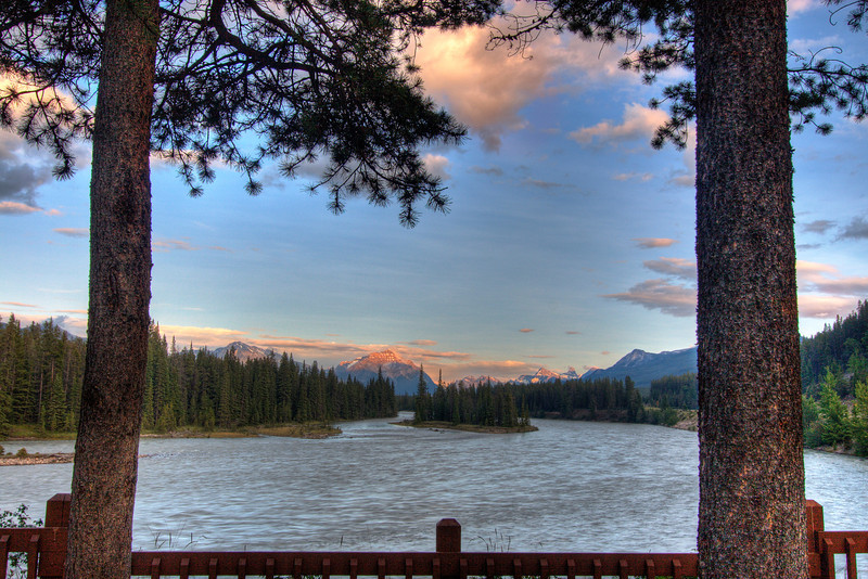 Natures natural framing of Mount Kerkeslin at sunset in the Majestic Canadian Rockies. This is in the town of Jasper and that is the powerful Athabasca River in the foreground.