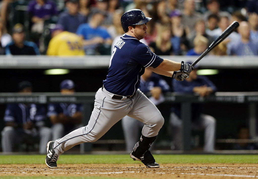 . San Diego Padres\' Jedd Gyorko follows the flight of his RBI-single against the Colorado Rockies in the fourth inning of a baseball game in Denver on Saturday, Sept. 6, 2014. (AP Photo/David Zalubowski)