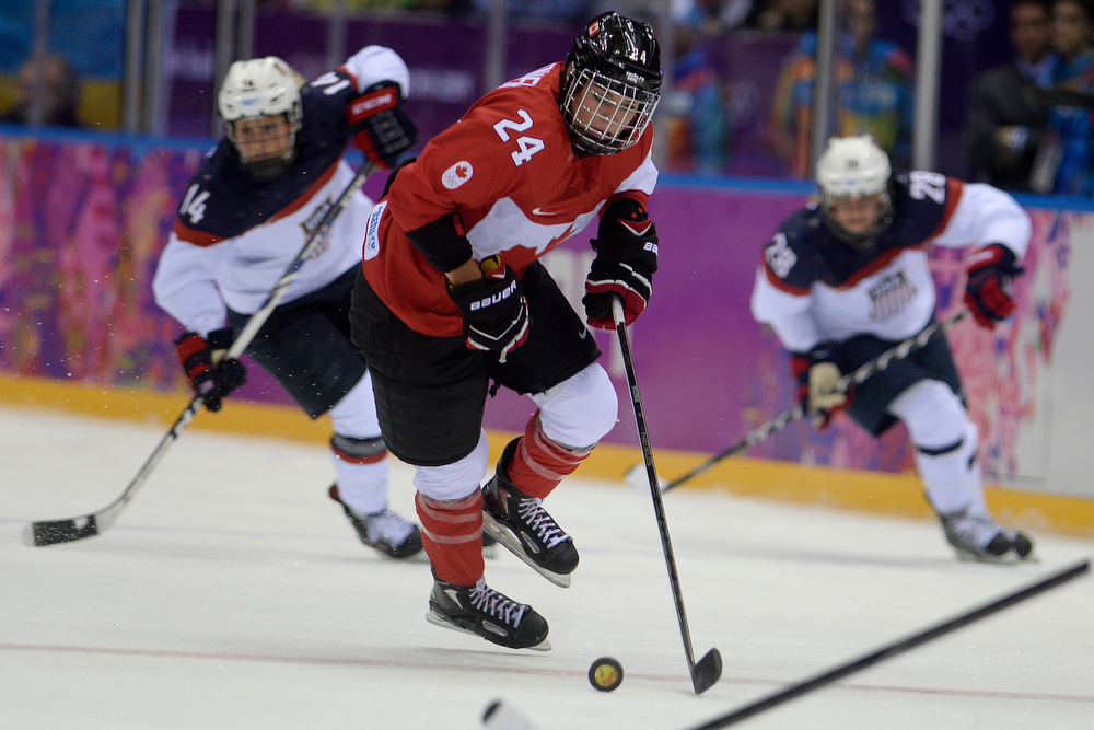 . Natalie Spooner (24) of the Canada controls the puck against the U.S.A. during the second period of the women\'s gold medal ice hockey game. Sochi 2014 Winter Olympics on Thursday, February 20, 2014 at Bolshoy Ice Arena. (Photo by AAron Ontiveroz/ The Denver Post)