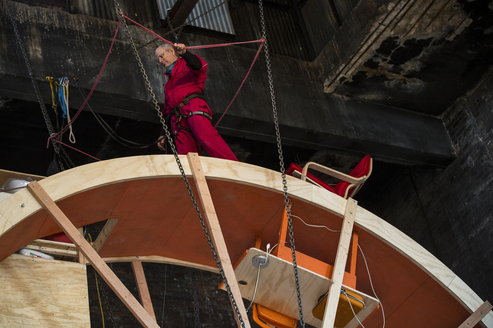 """. Ward Shelley, a professor, designer and artist, lives in the art installation piece titled, \""""In Orbit\"""" on March 5, 2014 in the Williamsburg neighborhood of the Brooklyn Borough of New York City. Shelley designed and constructed the space with Alex Schweder, who lives on the inner ring of the hamster wheel-like environment; they are in the midst of living in the wheel for ten days. The space was designed complete with beds, desks, a kitchen and bathroom and chair for relaxing.  (Photo by Andrew Burton/Getty Images)"""