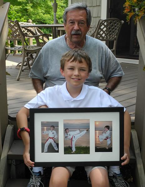 Grandpa and I with the frame we made and photos of me doing Taekwando.