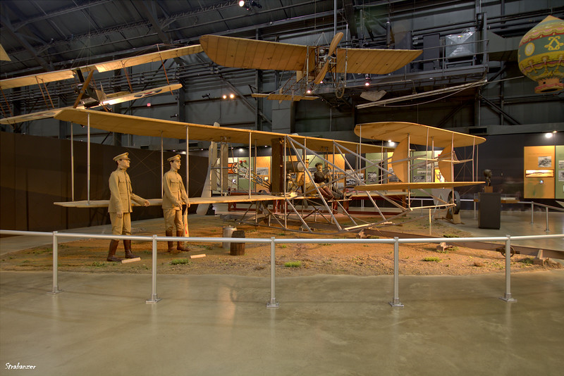 National Museum of the United States Air Force, Dayton, Ohio,   04/12/2019  Wright Military Flyer replica. Above hang a Bleriot Monoplane built in Ohio in 1911  from factory drawings and to its left a Standard J-1    This work is licensed under a Creative Commons Attribution- NonCommercial 4.0 International License.