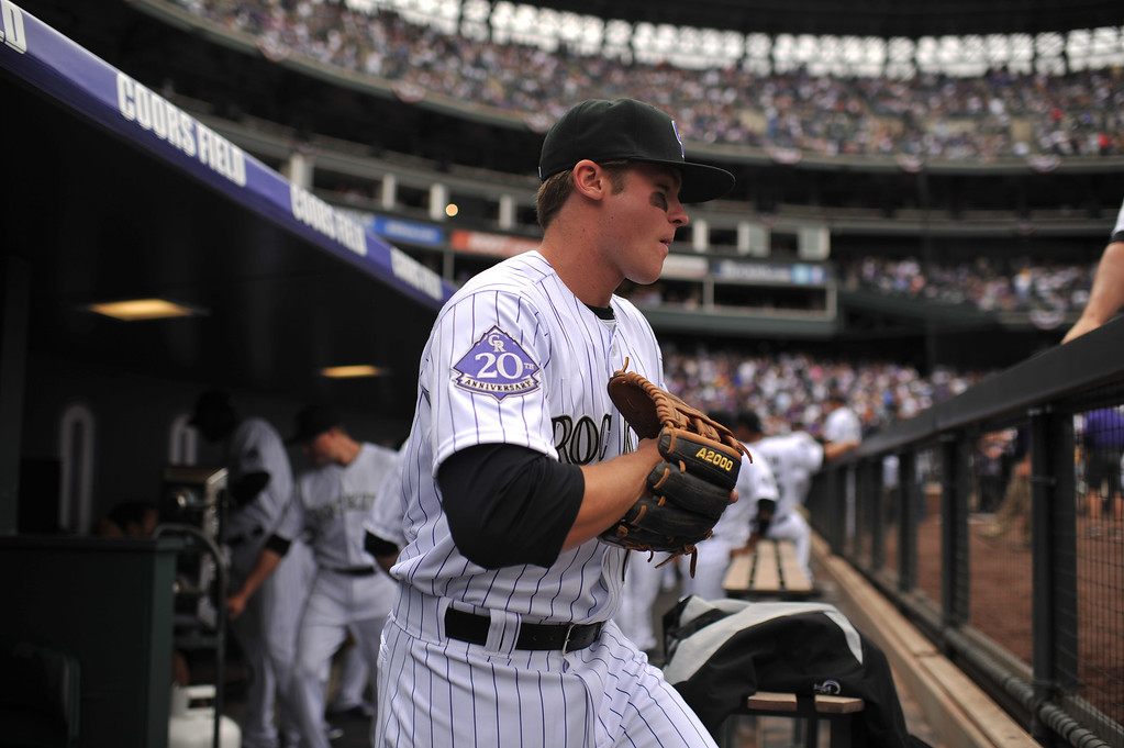 . Josh Rutledge (14) of the Colorado rockies takes the field for the first inning.  (Photo by Hyoung Chang/The Denver Post)