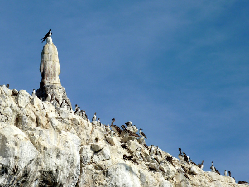 Piedras de la Virgen - Statue of the Virgin Mary with a Magnificent Frigate Bird crown.