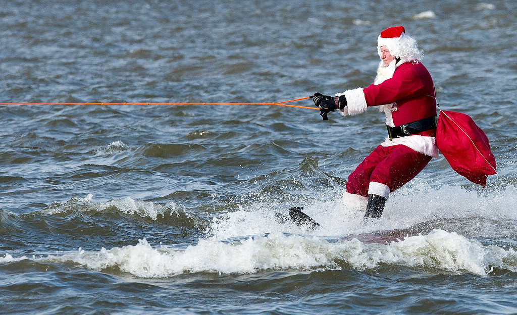 . The water skiing Santa Claus heads down the Potomoc River ON December 24, 2013 at National Harbor, Maryland, near Washington. The group of volunteers are celebrating their 28th anniversary of the event that also has kneeboarding reindeer, flying elves, the jet-sking Grinch, and Frosty the snowman.    AFP PHOTO/Paul J. RichardsPAUL J. RICHARDS/AFP/Getty Images