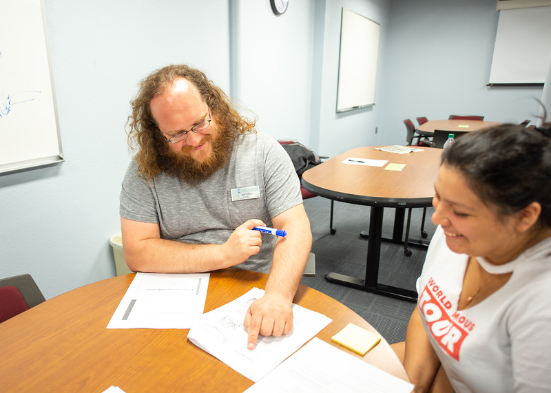 CASA tutor Jeffrey Schaffer (left) assists student Anqelika Anguano with her U.S. History Since 1865 coursework.  Click here http://bit.ly/1hswXLM for more information about the Center for Academic Student Achievement (CASA).