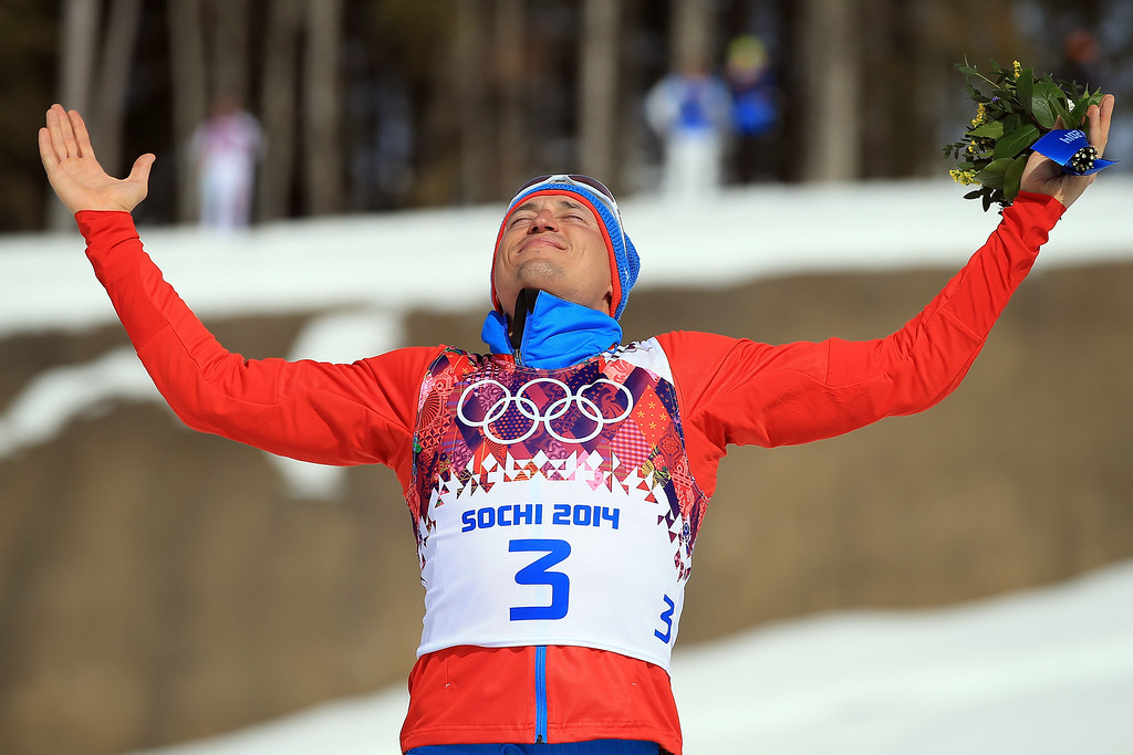 . Gold medalist Alexander Legkov of Russia celebrates during the flower ceremony for the Men\'s 50 km Mass Start Free during day 16 of the Sochi 2014 Winter Olympics at Laura Cross-country Ski & Biathlon Center on February 23, 2014 in Sochi, Russia.  (Photo by Richard Heathcote/Getty Images)