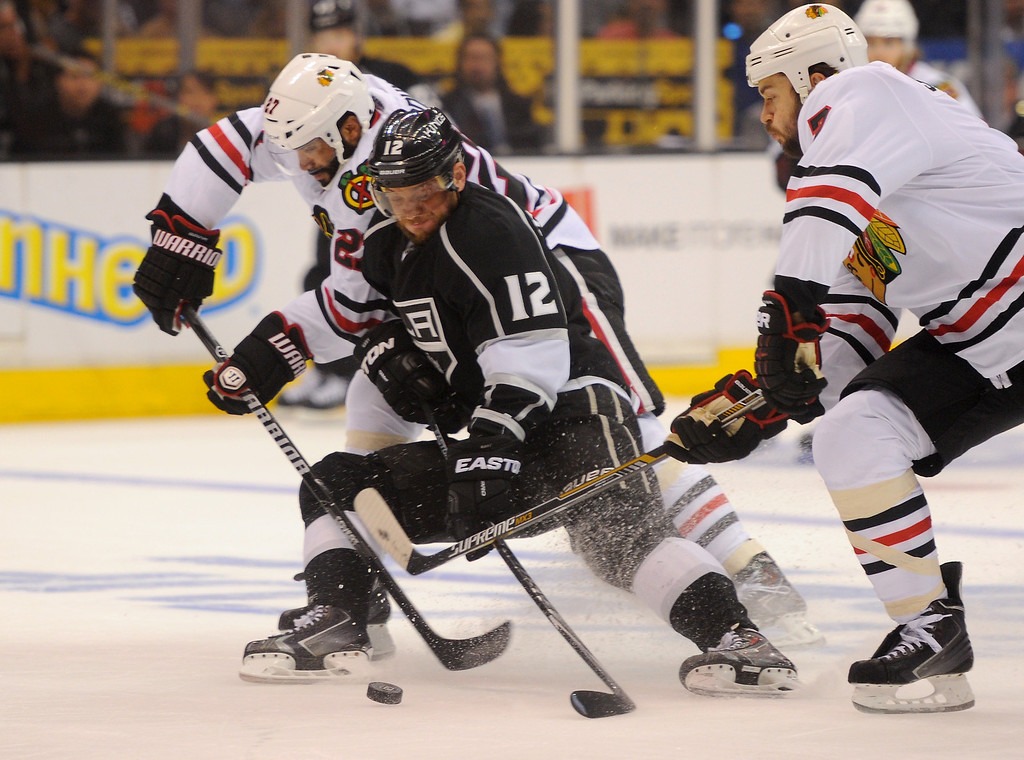 . The Kings\' Marian Gaborik battles the Blackhawks\' Johnny Oduya, left, and Brent Seabrook for the puck during game six of the Western Conference Finals, Friday, May 30, 2014, at Staples Center. (Photo by Michael Owen Baker/Los Angeles Daily News)
