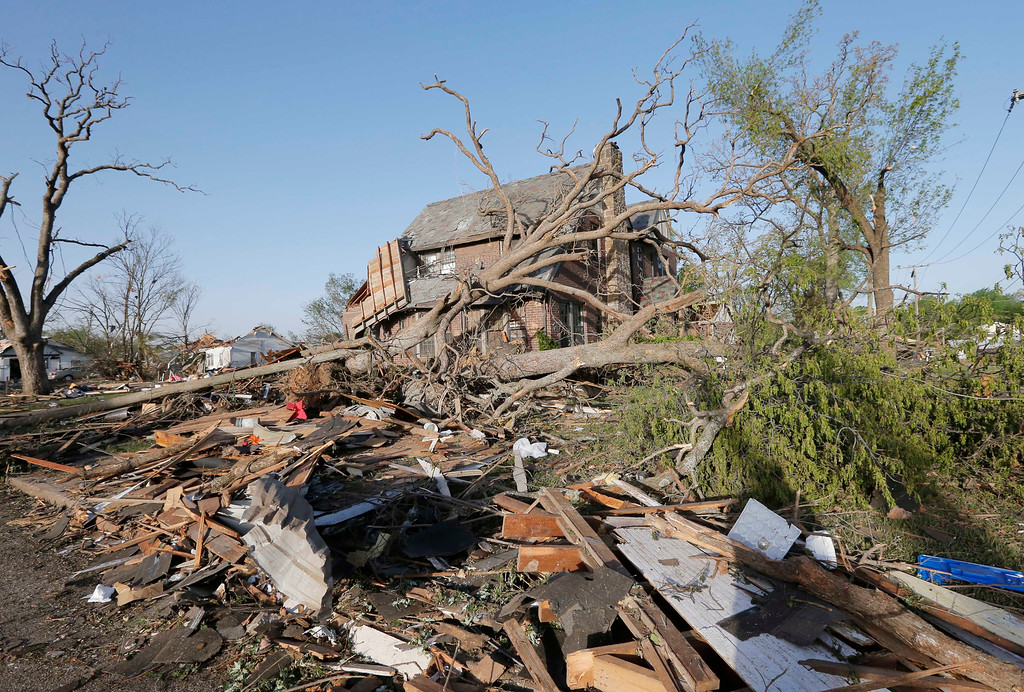 . A home is covered by debris from a tornado in Baxter Springs, Kan., Monday, April 28, 2014. Sunday\'s tornado damaged dozens of buildings and injured at least 25 people. (AP Photo/Orlin Wagner)