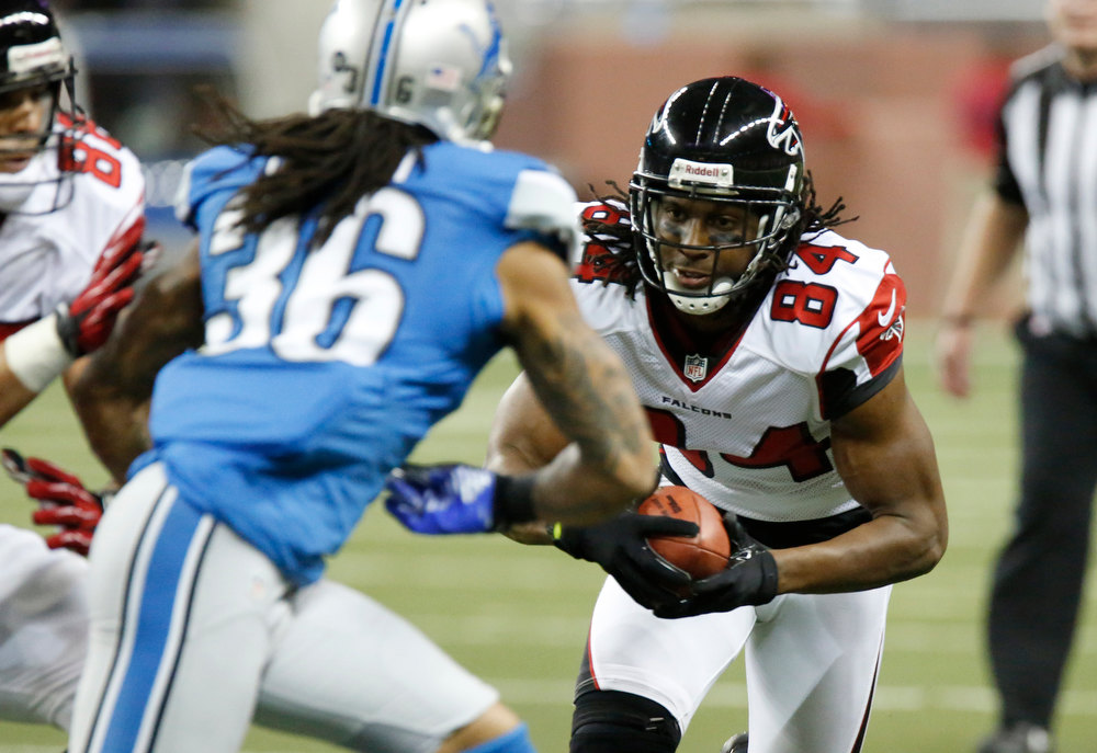 Description of . Atlanta Falcons wide receiver Roddy White, right, nears Detroit Lions cornerback Jonte Green (36) on the way to a 39-yard touchdown during the second quarter of an NFL football game at Ford Field in Detroit, Saturday, Dec. 22, 2012. (AP Photo/Duane Burleson)