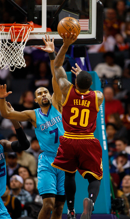 . Cleveland Cavaliers guard Kay Felder (20) shoots over Charlotte Hornets guard Ramon Sessions (7) in the first half of an NBA basketball game in Charlotte, N.C., Saturday, Dec. 31, 2016. (AP Photo/Nell Redmond)