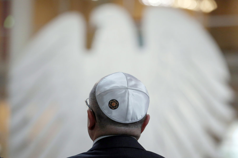 Description of . A visitor wearing a kippah attends a commemorative event for the victims of the Nazi era at the German Bundestag parliament in Berlin, Germany, Jan. 30, 2013. On the 80th anniversary of Adolf Hitler's rise to power, Chancellor Angela Merkel urged Germans to always fight for their principles and not fall into the complacency that enabled the Nazi dictator to seize control. (AP Photo/dpa, Kay Nietfeld)