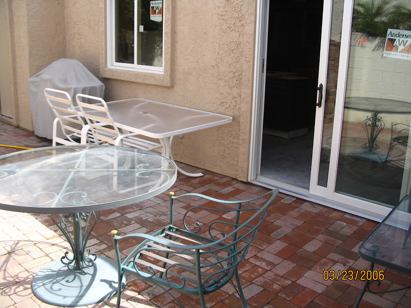 Side yard, with miscellaneous furniture, some of which we kept (green) and others of which we gave away (white).