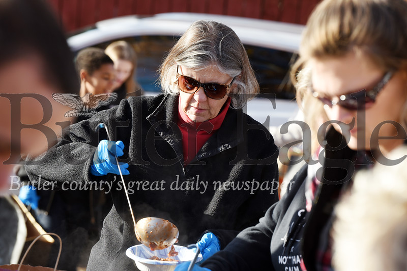Harold Aughton/Butler Eagle: Members of the Victory Church served hot meals and handed out frozen turkeys to those gathered in Rotary Park Sunday afternoon, Nov. 17, 2019.