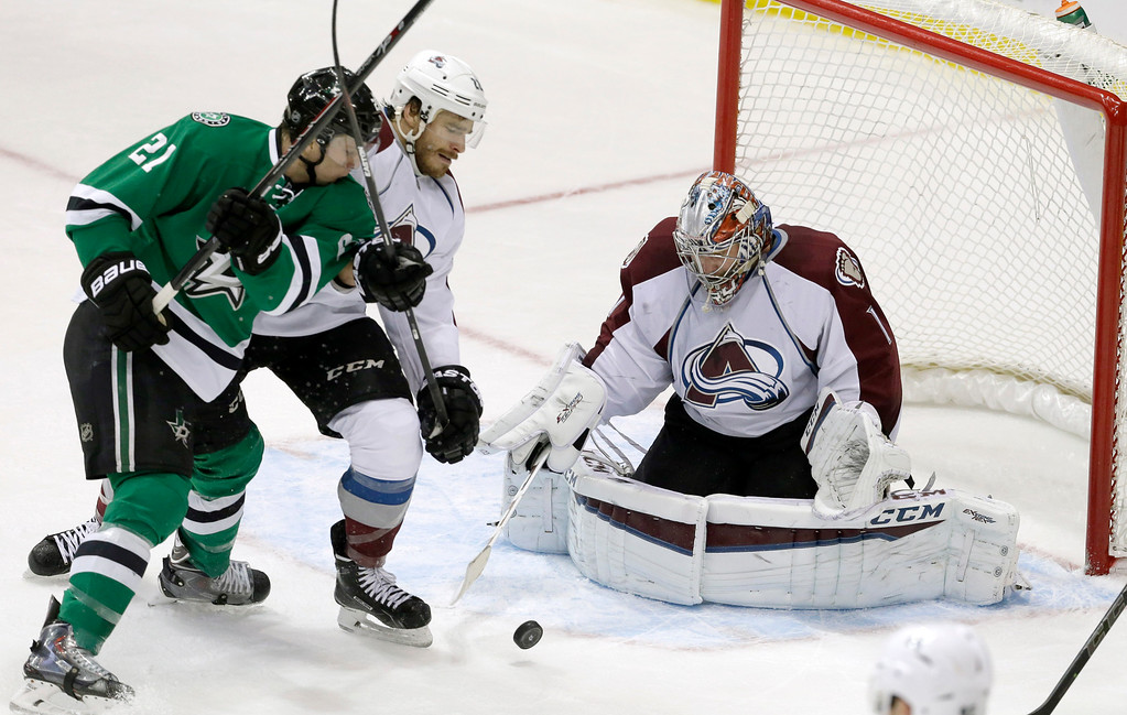 . Colorado Avalanche goalie Semyon Varlamov (1) and Zach Redmond (22) defend the goal against Dallas Stars left wing Antoine Roussel (21) during the second period of an NHL hockey game Tuesday, Feb. 3, 2015, in Dallas. (AP Photo/LM Otero)