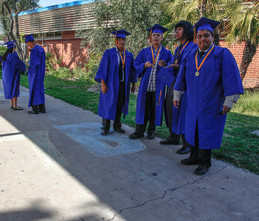 . Chalk marks the spot graduates will line up at. Pictured are Leroy Wallter, Danny Haiwongse Jr., Richard Maroon Velazquez & Gabriel Andres Serrano ready themselves for the processional at John H Francis Polytechnic High School, Sun Valley, Calif., June 7, 2013. Photo: Lynn Levitt.