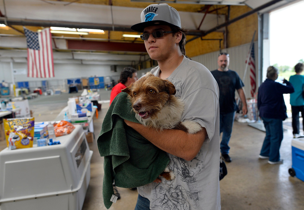 . Brandon Sarrels brings a dog, that his mother found in the rubble of a tornado devastated house, to a pet shelter on May 23, 2013 in Moore, Oklahoma. Monday\'s tornado in this Oklahoma City suburb damaged or destroyed 1,200 homes and affected 33,000 people, officials said Thursday. Updating figures from one of the worst US tornados in recent years, they said the death toll from the powerful twister -- which struck with little notice in mid-afternoon -- remains at 24, with 377 injured. JEWEL SAMAD/AFP/Getty Images