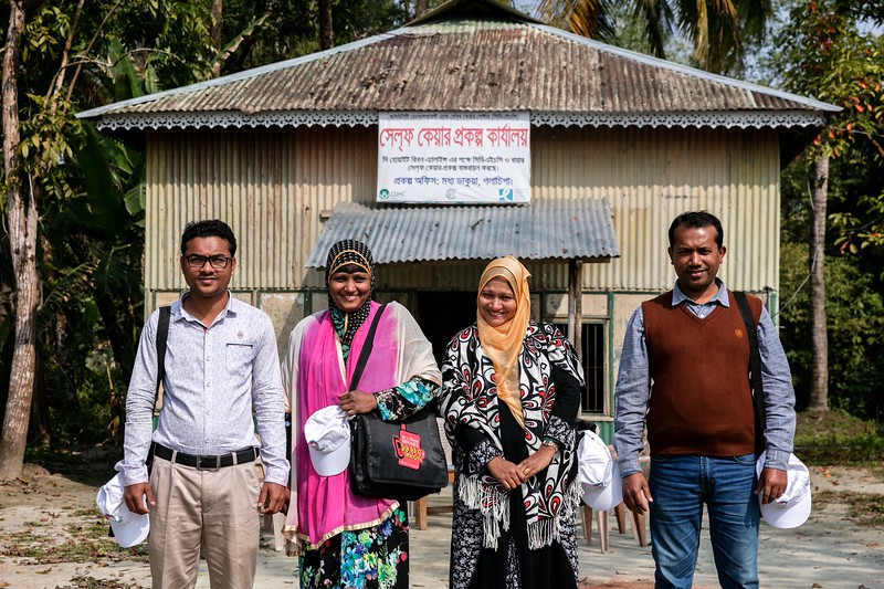 0242-0245CDHC workers posing for group photo in front of Self-care project office, Middle Dakua.Middle Dakua, Dakua Union Golachepa, Potuakhali. Bangladesh.Photo Credit: b.a.sujaN / Map / WRA