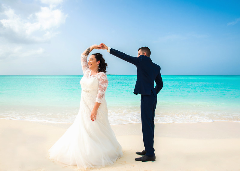 Beach Wedding at Paradise Bay Resort in Exuma Bahamas photo by Reno Curling #renocurling
