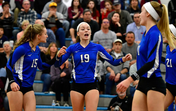 11/8/2018 Mike Orazzi | Staff Bristol Eastern High School's Rebecca Bender (15) and Amber Blais (19) during the Class L Second Round State Girls Volleyball Tournament in Bristol Thursday night.